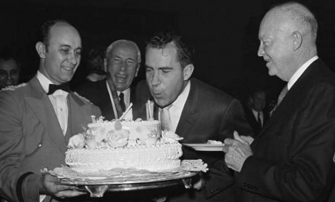 Richard Nixon blows out the candles on his 48th birthday: Jan. 9, 1961.