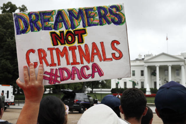 <p>A woman holds up a sign in support of the Obama administration program known as Deferred Action for Childhood Arrivals, or DACA, during an immigration reform rally at the White House in Washington on Aug. 15, 2017. After months of delays, President Donald Trump is expected to decide soon on the fate of so -alled DREAMers who were brought into the country illegally as children as he faces a looming court deadline and is digging in on appeals to his base. (Photo: Jacquelyn Martin/AP) </p>