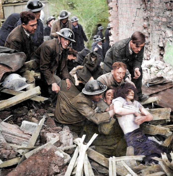 <p>Rescuers with an 'R' on their helmets pull a bomb victim from the rubble. (MediaDrumWorld) </p>