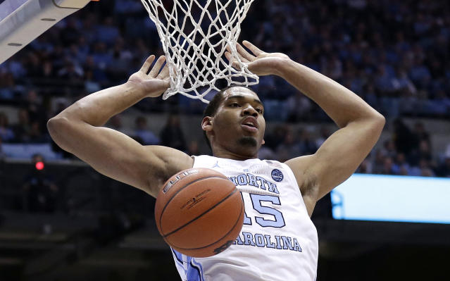 North Carolina's Garrison Brooks (15) dunks against Virginia Tech during the first half of an NCAA college basketball game in Chapel Hill, N.C., Monday, Jan. 21, 2019. (AP Photo/Gerry Broome)