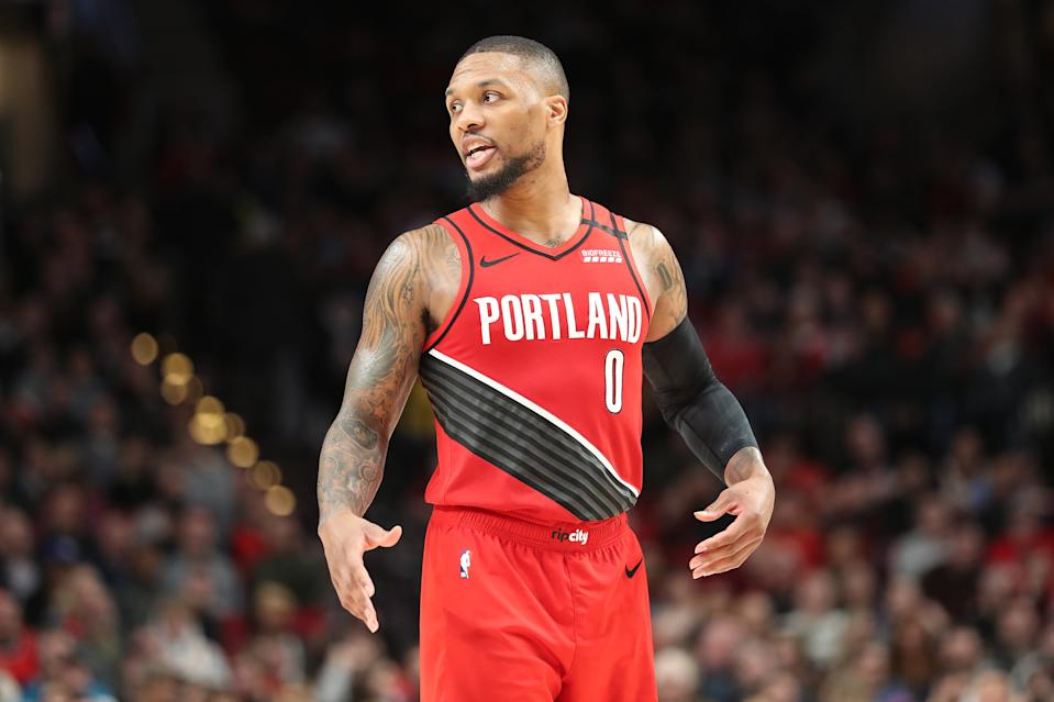 In an emotional night at Staples Center, Damian Lillard nearly posted a triple-double to lead the Trail Blazers past the Lakers. (Abbie Parr/Getty Images)