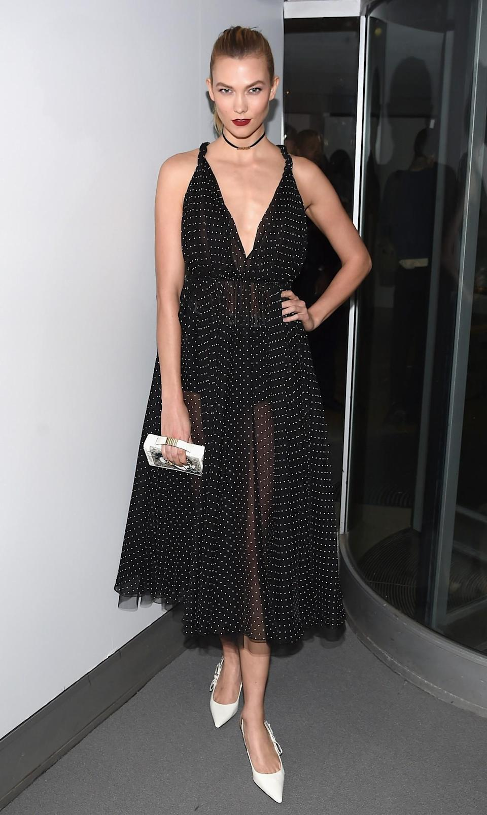 <p>The statuesque model towered over everyone in a feminine polka dot dress worn with chic white pumps. <i>[Photo: Getty]</i> </p>