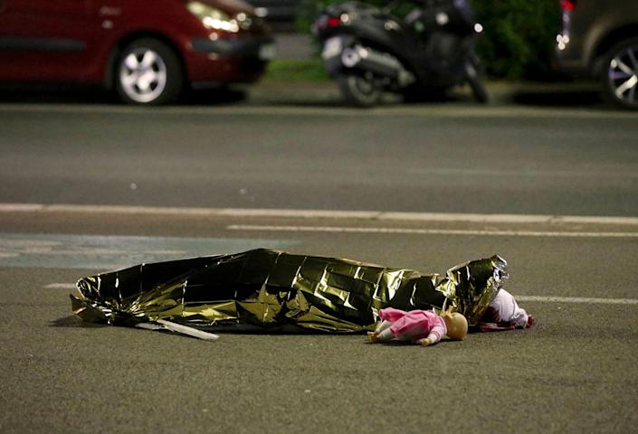 <p>JUL. 15, 2016 — A body is seen on the ground in Nice, France after the Bastille Day truck attack on July 14. (Eric Gaillard/Reuters) </p>