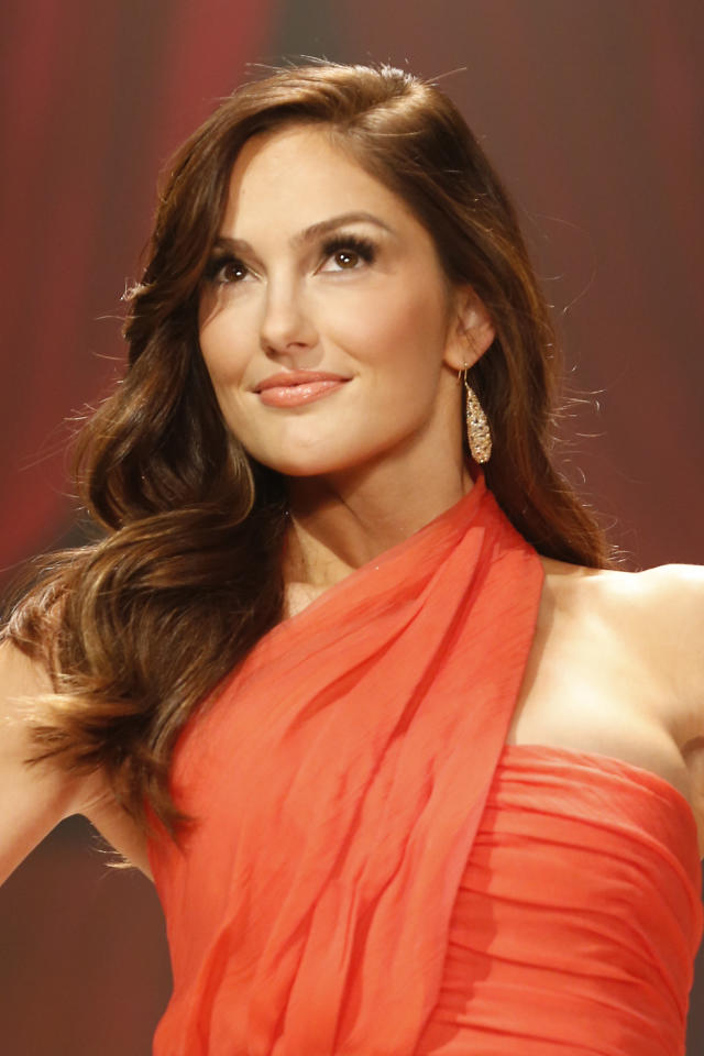 Minka Kelly walks the runway at the Red Dress Collection 2013 Fashion Show, on Wednesday, Feb. 6, 2013 in New York. (Photo by John Minchillo/Invision/AP)
