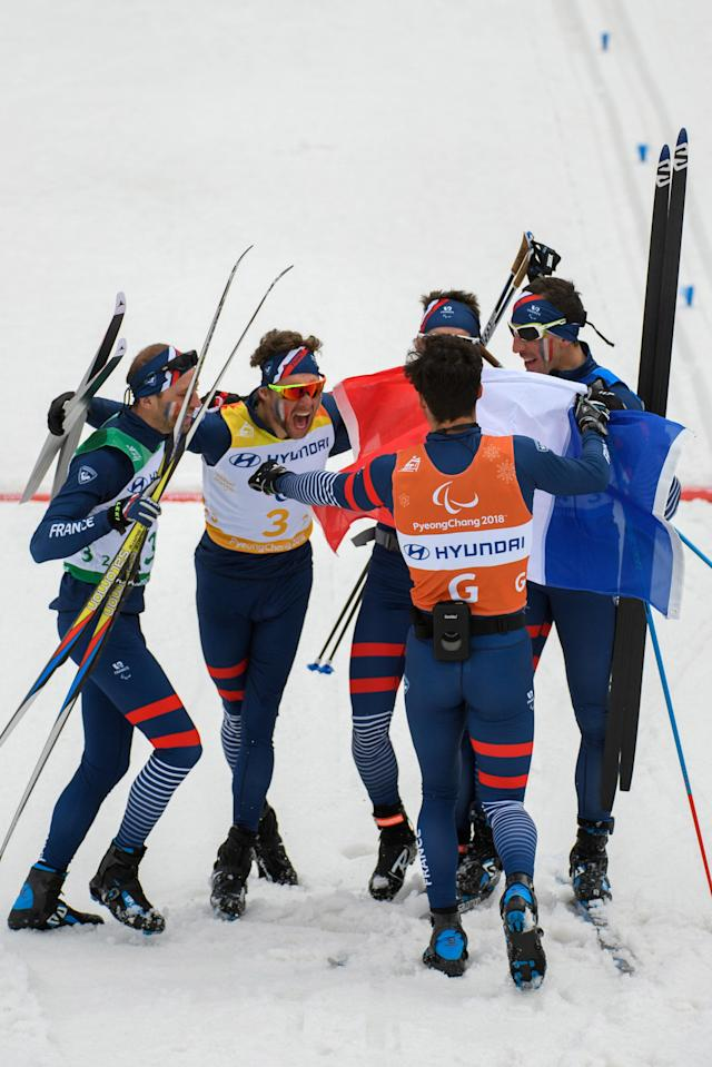 Benjamin Daviet of France (2L), Anthony Chalencon of France (L) and team-mates celebrate after France won the Cross Country Skiing 4x2.5km Open Relay at the Alpensia Biathlon Centre. The Paralympic Winter Games, PyeongChang, South Korea, Sunday 18th March 2018. OIS/IOC/Thomas Lovelock/Handout via Reuters