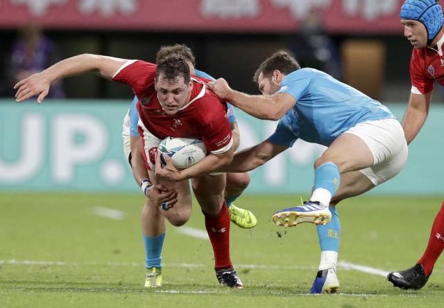 Wales' Ryan Elias is tackled during the Rugby World Cup Pool D game at Kumamoto Stadium between Wales and Uruguay in Kumamoto, Japan, Sunday, Oct. 13, 2019. (AP Photo/Aaron Favila)