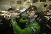 Seattle Sounders' Victor Rodriguez, who scored a goal in the match, drinks from the cup Sunday, Nov. 10, 2019, after defeating Toronto FC in the MLS Cup championship soccer match in Seattle. The Sounders won 3-1. (AP Photo/Ted S. Warren)