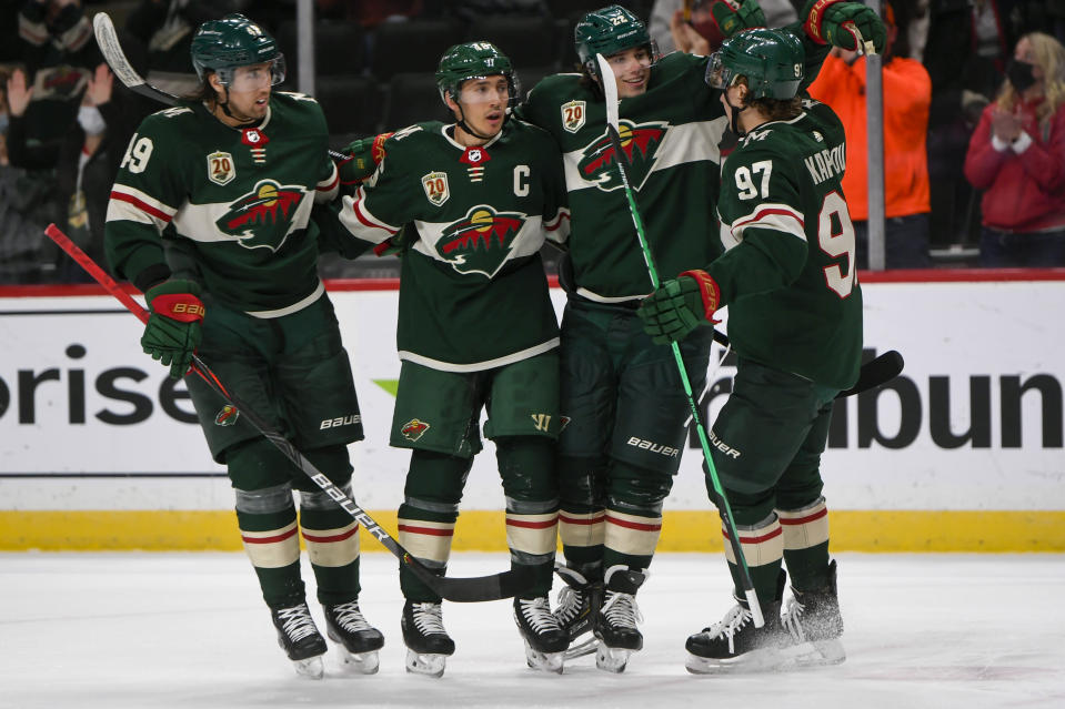 Minnesota Wild center Victor Rask, defenseman Jared Spurgeon, left wing Kevin Fiala and left wing Kirill Kaprizov, from left, celebrate after Spurgeon scored a goal against the Anaheim Ducks with an assist from Kaprizov during the first period of an NHL hockey game Saturday, May 8, 2021, in St. Paul, Minn. (AP Photo/Craig Lassig)