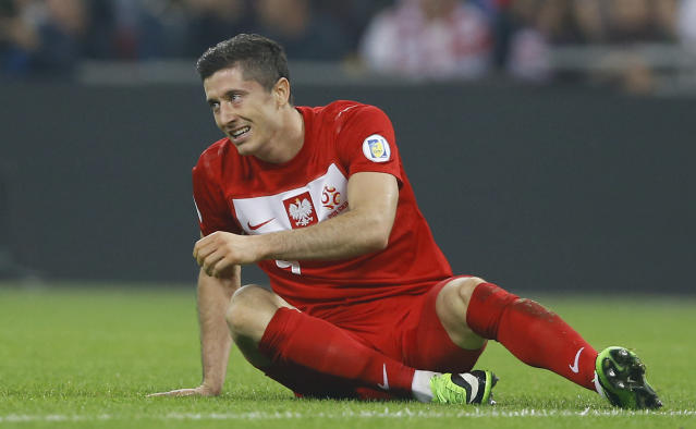 Poland's Robert Lewandowski looks round as he gets up from the pitch after missing chance to score a goal during the World Cup Group H qualification soccer match between England and Poland at Wembley stadium in London, Tuesday, Oct. 15, 2013. (AP Photo/Kirsty Wigglesworth)