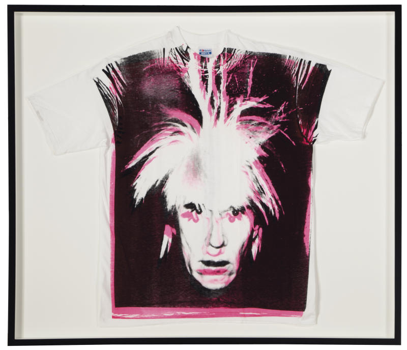 """This undated photo provided by Christies's auction house in New York shows Andy Warhol's """"Self-Portrait with Fright Wig screenprint on t-shirt,"""" with a pre-auction estimate of $15,000 - $20,000. It is one of about 125 artworks being offered from Feb. 26 through March 5 in Christie's first online-only Warhol sale. The works can be previewed online prior to the sale. Bidders can browse, bid and receive instant updates by email or phone if another bid exceeds theirs. (AP Photo/Christie's)"""