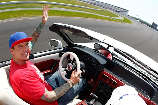 LONG POND, PA - JUNE 10: Vanilla Ice, Honorary Pace Car Driver for the NASCAR Sprint Cup Series Pocono 400 presented by #NASCAR, drives the Ford Mustang 5.0 from the movie That's My Boy, around the Pocono Raceway before the start of the race on June 10, 2012 in Long Pond, Pennsylvania. (Photo by Jeff Zelevansky/Getty Images for NASCAR)