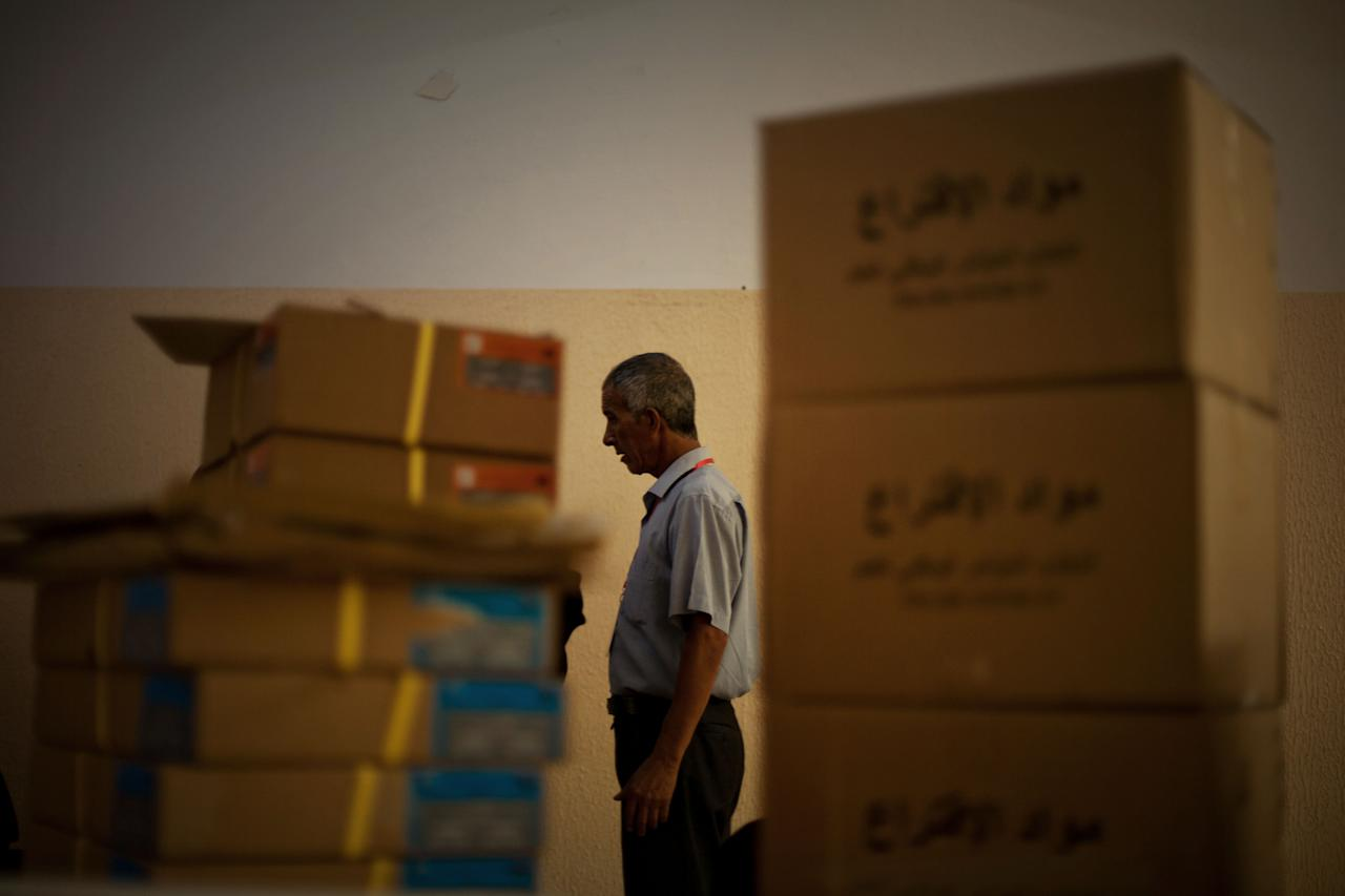 An electoral official prepares a polling station for the National Assembly election in Tripoli, Libya, Friday, July 6, 2012. The Libyan National Assembly elections will take place on July 7, 2012 and will be the first free elections since 1969. (AP Photo/Manu Brabo)
