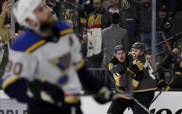 Vegas Golden Knights center Jonathan Marchessault, right, celebrates with right wing Mark Stone (61) after scoring a power-play goal against the St. Louis Blues in overtime of an NHL hockey game Thursday, Feb. 13, 2020, in Las Vegas. The Golden Knights won 6-5. (AP Photo/Isaac Brekken)