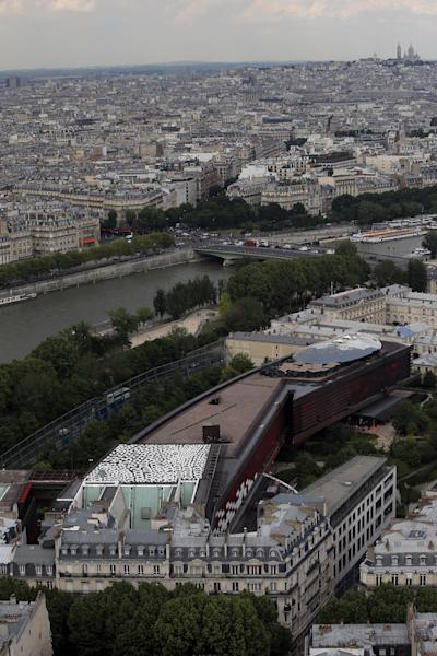 The huge 700m squared black and white painting by Aboriginal artist Lena Nyadbi of Australia, on top of the Quai Branly Museum, as seen from the Eiffel Tower in Paris, Thursday, June 6, 2013. Art is often seen as lofty - but none more than a new roof installation in Paris that's only visible from the top of the Eiffel tower and Google Earth. (AP Photo/Francois Mori)