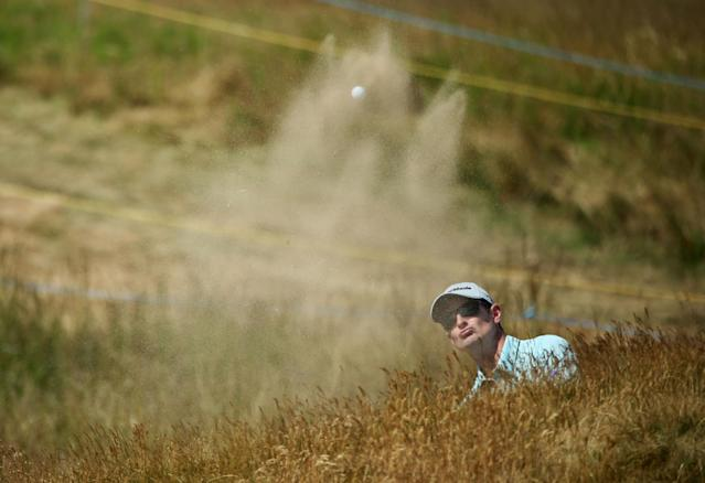 GULLANE, SCOTLAND - JULY 17: Justin Rose of England hits out of a bunker ahead of the 142nd Open Championship at Muirfield on July 17, 2013 in Gullane, Scotland. (Photo by Andy Lyons/Getty Images)