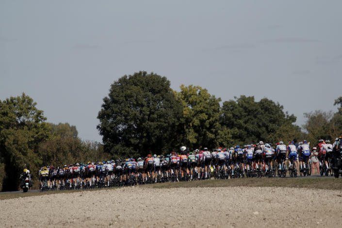 FILE - In this Sept.9, 2020 file photo, the pack rides during the eleventh stage of the Tour de France cycling race over 167 kilometers (104 miles), with start in Chatelaillon-Plage and finish in Poitiers. (AP Photo/Christophe Ena, File)