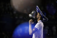 Germany's Alexander Zverev kisses his trophy as confetti falls after he defeated Greece's Stefanos Tsitsipas in the final match to win the Mexican Open tennis tournament in Acapulco, Mexico, Saturday, March 20, 2021. (AP Photo/Rebecca Blackwell)