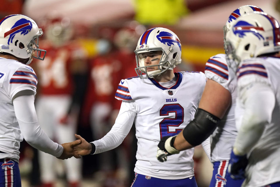 Buffalo Bills place kicker Tyler Bass (2) celebrates with teammates after kicking a 20-yard field goal during the first half of the AFC championship NFL football game against the Kansas City Chiefs, Sunday, Jan. 24, 2021, in Kansas City, Mo. (AP Photo/Charlie Riedel)