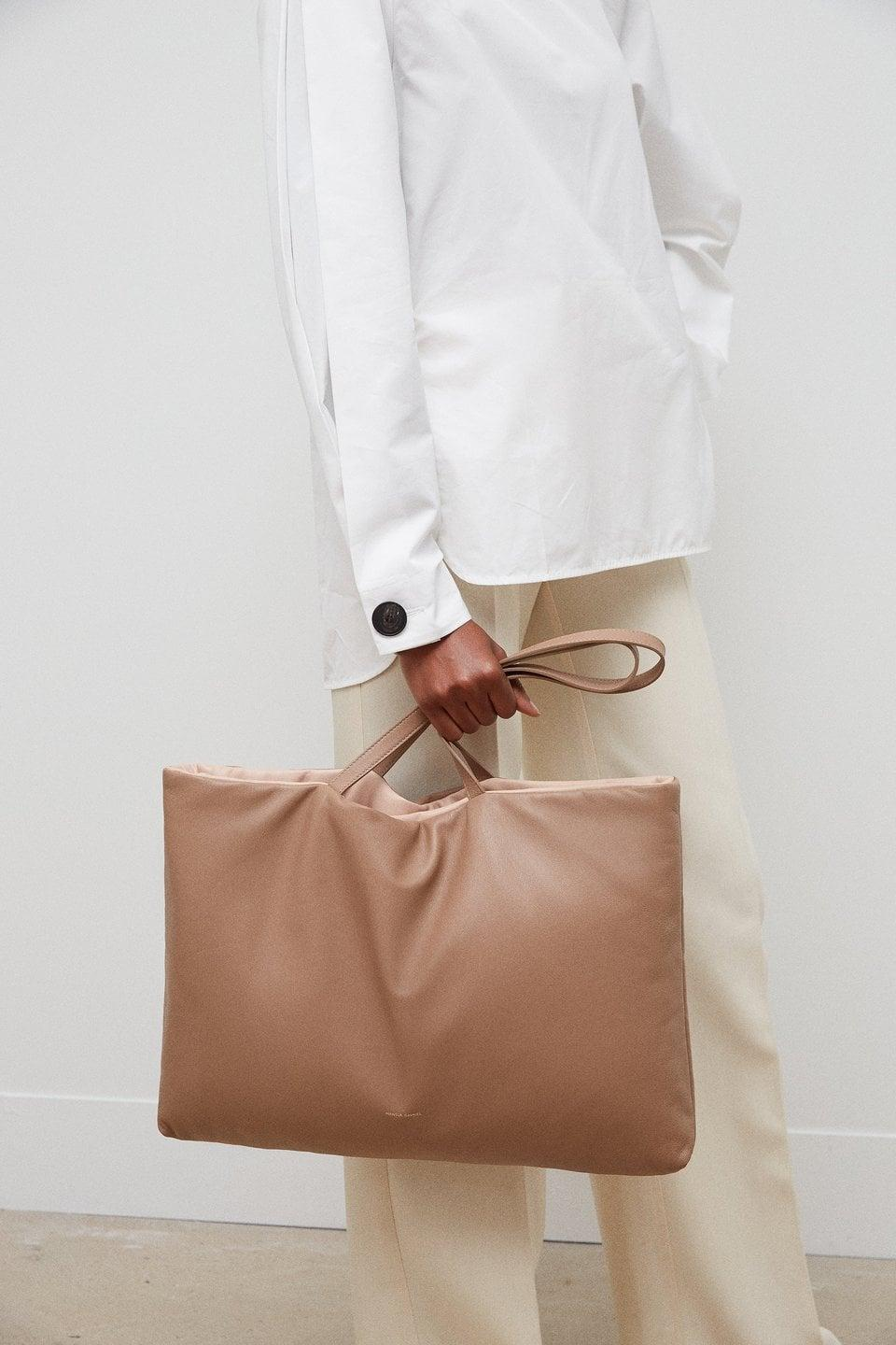 <p>Behold, the <span>Mansur Gavriel Reversible Pillow Tote Bag</span> ($795) is your perfect bag. It's even reversible.</p>