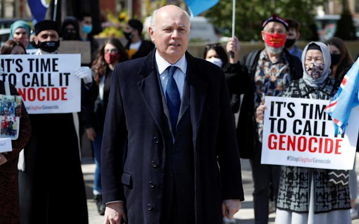 Iain Duncan Smith joins a protest against Uyghur genocide - Reuters
