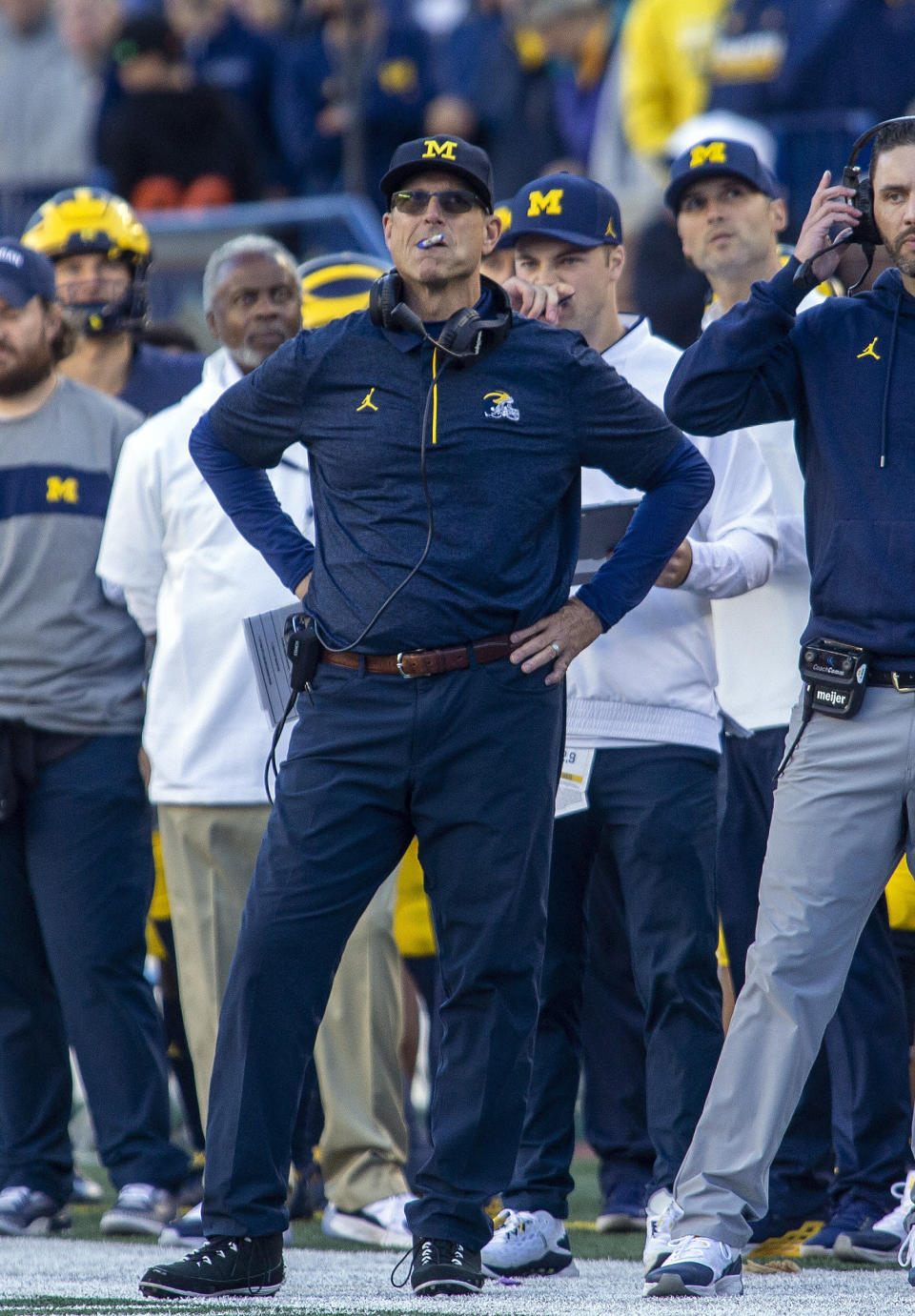 Michigan head coach Jim Harbaugh looks at the scoreboard from the sideline in the fourth quarter of an NCAA college football game against Rutgers in Ann Arbor, Mich., Saturday, Sept. 25, 2021. Michigan won 20-13. (AP Photo/Tony Ding)