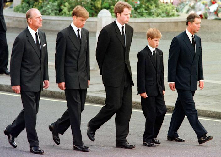 Image: Prince Philip, Prince William, Earl Spencer, Prince Harry and Prince Charles walk outside Westminster Abbey during the funeral service for Diana on Sept. 6, 1997. (Jeff J. Mitchell / AFP - Getty Images file)