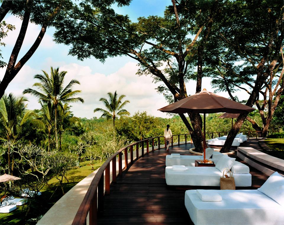 """Eyebrow-arching views greet you as you arrive at COMO Shambhala Estate on the island of <a href=""""https://www.cntraveler.com/destinations/bali?mbid=synd_yahoo_rss"""" rel=""""nofollow noopener"""" target=""""_blank"""" data-ylk=""""slk:Bali"""" class=""""link rapid-noclick-resp"""">Bali</a>, a jungle-hugged designer health retreat on staggered hilltops above the Ayung River. For more than two decades, COMO Shambhala has reigned as a five-star refuge for luxury travelers looking to say farewell to stress and hello to spiritual development. East meets West at each of its 30 rooms, suites, and pool villas, whose otherwise spare interiors house hand carvings and fine antiques. (Stand-alone villas have private pools, and one-bedroom Retreat Villas have their own treatment rooms.) If it's wellness you want, there's a reason COMO Shambhala is one of our readers' <a href=""""https://www.cntraveler.com/galleries/2015-04-10/best-resorts-in-asia-readers-choice-awards-2014?mbid=synd_yahoo_rss"""" rel=""""nofollow noopener"""" target=""""_blank"""" data-ylk=""""slk:favorite resorts in Asia"""" class=""""link rapid-noclick-resp"""">favorite resorts in Asia</a>: it's grander and more graceful than conventional spas; it's more transformative and soothing than corporate chain resorts; and it has every tropical panorama fit for Instagram. <em>(Editor's note: The hotel is currently closed, and slated to reopen December 1, 2021.)</em>"""