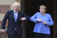 Britain's Prime Minister Boris Johnson, left, gestures as he welcomes German Chancellor Angela Merkel, before their bilateral meeting at Chequers, the country house of the Prime Minister, in Buckinghamshire, England, Friday July 2, 2021. Johnson is likely to push Angela Merkel to drop her efforts to impose COVID-19 restrictions on British travelers as the German chancellor makes her final visit to Britain before stepping down in the coming months. Johnson will hold talks with Merkel at his country residence on Friday. (Stefan Rousseau/Pool Photo via AP)