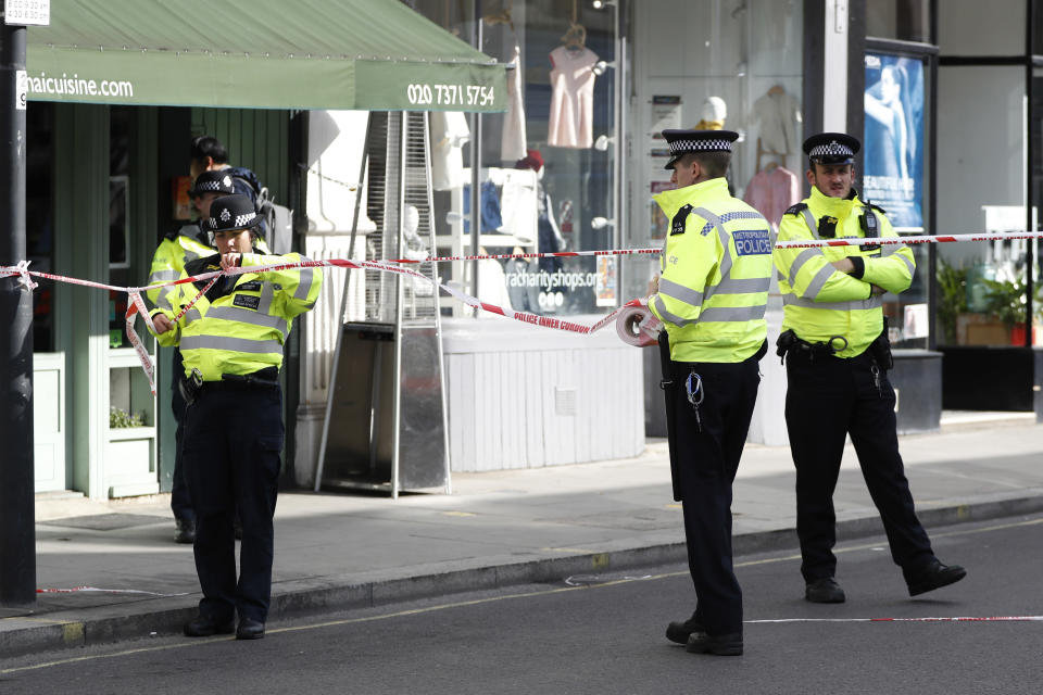 <em>Cordon – the area remains cordoned off as investigations begin into the terrorist attack (Picture: AP Photo/Kirsty Wigglesworth)</em>