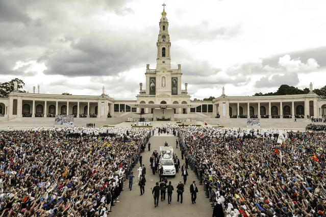 "<p>Pope Francis in his popemobile leaves at the end of a Mass where he canonized shepherd children Jacinta and Francisco Marto at the Sanctuary of Our Lady of Fatima, May 13, 2017, in Fatima, Portugal. Pope Francis urged Catholics on Friday to ""tear down all walls"" and spread peace as he traveled to this Portuguese shrine town to canonize two poor, illiterate shepherd children whose visions of the Virgin Mary 100 years ago marked one of the most important events of the 20th-century Catholic Church. (Photo: AP) </p>"