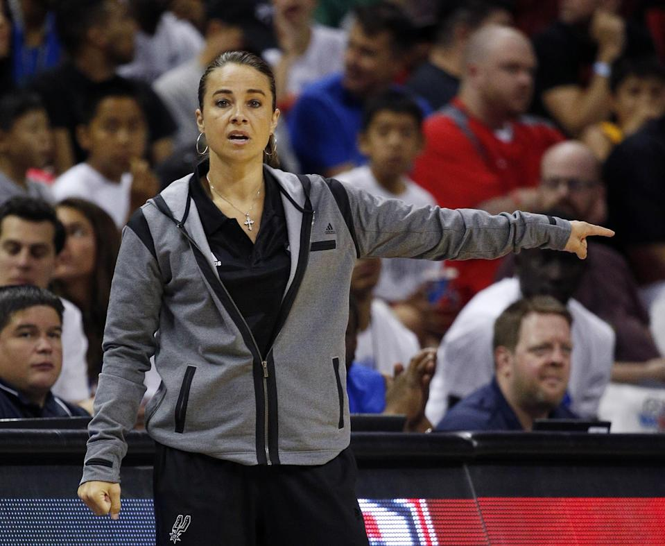 Becky Hammon joined Gregg Popovich's staff after retiring from the WNBA's San Antonio Silver Stars in 2014. (AP)