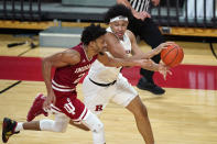 Rutgers guard Ron Harper Jr., right, looks to pass the ball as Indiana guard Armaan Franklin (2) defends during the second half of an NCAA college basketball game Wednesday, Feb. 24, 2021, in Piscataway, N.J. (AP Photo/Kathy Willens)