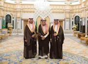 Saudi King Salman bin Abdulaziz Al Saud poses for a photo with National Guard Minister Khaled bin Ayyaf and Economy Minister Mohammed al-Tuwaijri during a swearing-in ceremony in Riyadh, Saudi Arabia, November 6, 2017. Saudi Press Agency/Handout via REUTERS