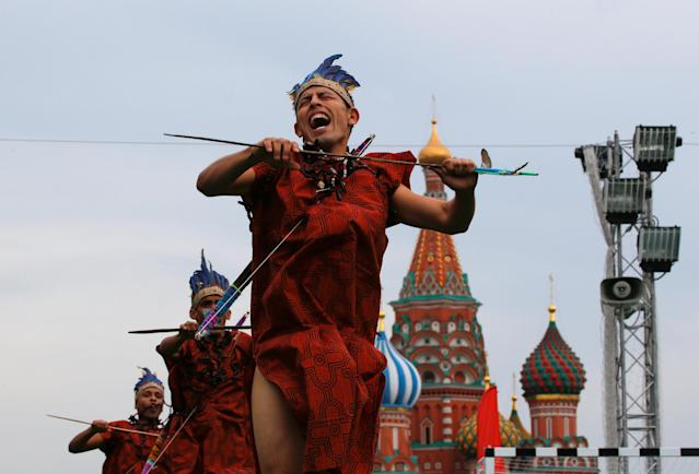 Participants perform during the Peru Day event in the World Cup Football Park in front of St. Basil's Cathedral in Red Square in central Moscow, Russia June 24, 2018. REUTERS/Sergei Karpukhin