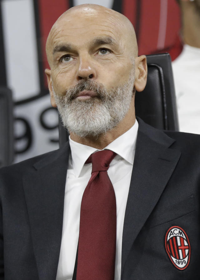 AC Milan's manager Stefano Pioli looks on at the start of Serie A soccer match between AC Milan and Lecce, at the San Siro stadium in Milan, Italy, Sunday, Oct.20, 2019. (AP Photo/Luca Bruno)