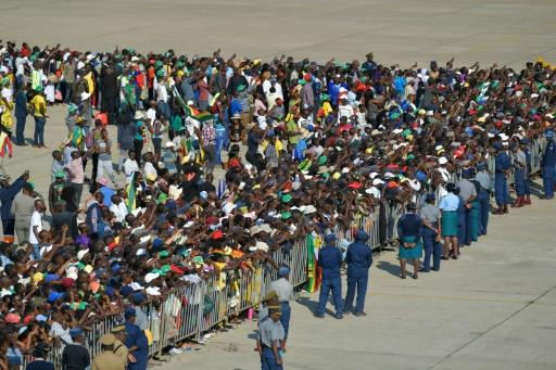 Around two thousand supporters, family members and government officials were on the tarmac at Harare airport to welcome Mugabe's remains