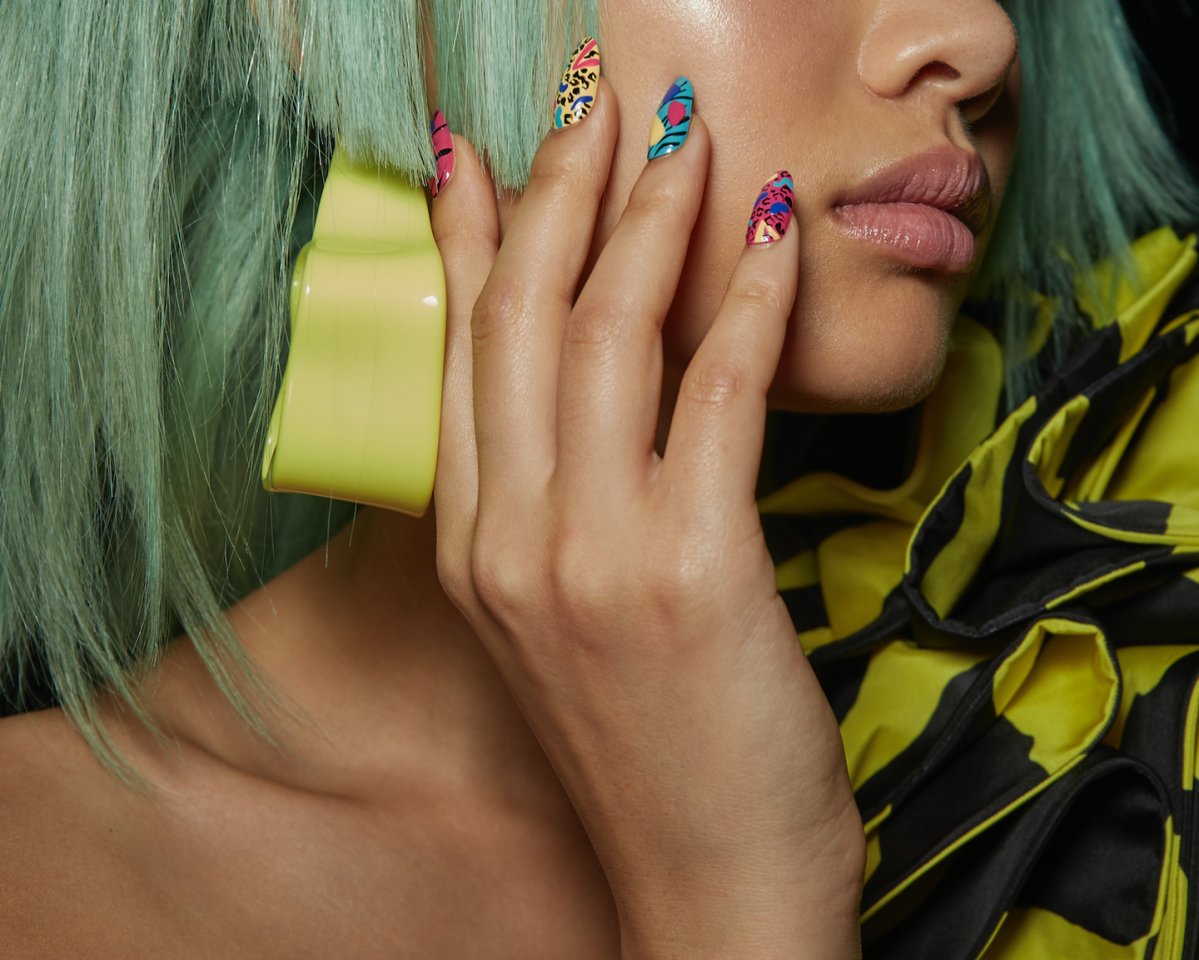 """<p>""""We're leaning into the wild side of the '80s,"""" said manicurist Miss Pop. She used a combination of No Place Like Chrome, Mod Square, In the Cab-ana, Butler Please, Hay There, and Licorice from Essie to create the geometric look.</p><p><strong>Essie</strong> Butler Please, $5.96, amazon.com. <a class=""""body-btn-link"""" href=""""https://www.amazon.com/Polish-Glossy-Finish-Butler-Please/dp/B00GJ782FI/ref=sr_1_2?crid=1OHCFXAXYAOZM&keywords=essie+butler+please&qid=1568047437&s=beauty&sprefix=essie+butl%2Cbeauty%2C123&sr=1-2&tag=syn-yahoo-20&ascsubtag=%5Bartid%7C10056.g.28966333%5Bsrc%7Cyahoo-us"""" target=""""_blank"""">SHOP</a></p>"""