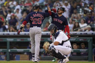 Boston Red Sox left fielder J.D. Martinez (28) celebrates his solo home run with Alex Verdugo as Detroit Tigers catcher Grayson Greiner (17) looks on in the second inning of a baseball game in Detroit, Wednesday, Aug. 4, 2021. (AP Photo/Paul Sancya)
