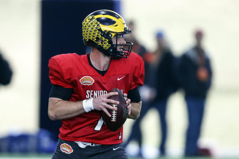 Michigan's Shea Patterson looks to pass as the North squad practices for the Senior Bowl Thursday, Jan. 23, 2020, in Mobile, Ala. (AP Photo/Butch Dill)