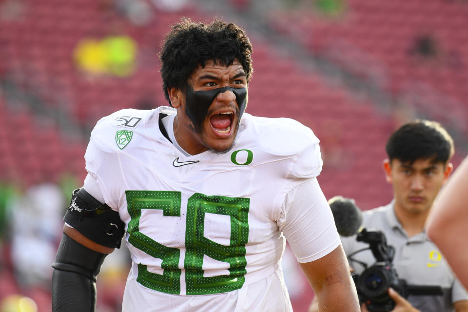 Oregon OT Penei Sewell possesses as much potential as any left tackle to come along the past few years. (Photo by Brian Rothmuller/Icon Sportswire via Getty Images)