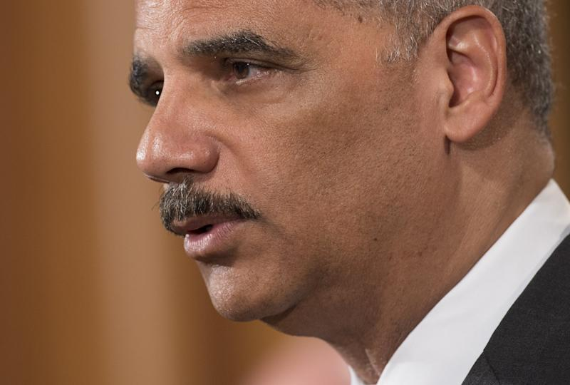 US Attorney General Eric Holder speaks during a press conference at the US Justice Department in Washington, DC, on June 30, 2014