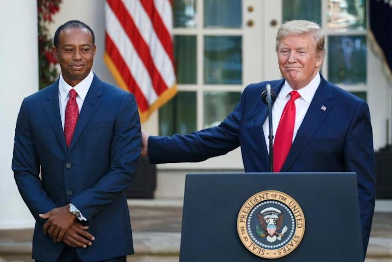 Donald Trump and Tiger Woods | SHAWN THEW/EPA-EFE/Shutterstock