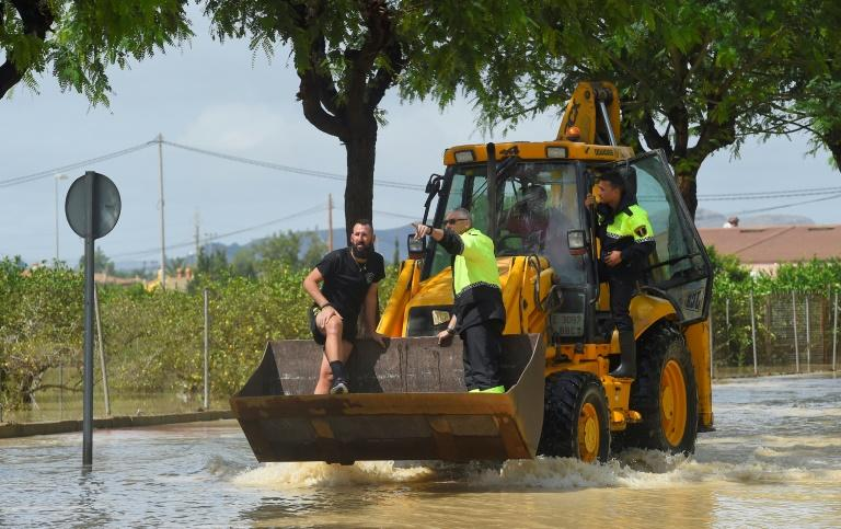 In flooded Redovan, some 50km (30 miles) southwest of Alicante, some people were being evacuated with diggers (AFP Photo/JOSE JORDAN)