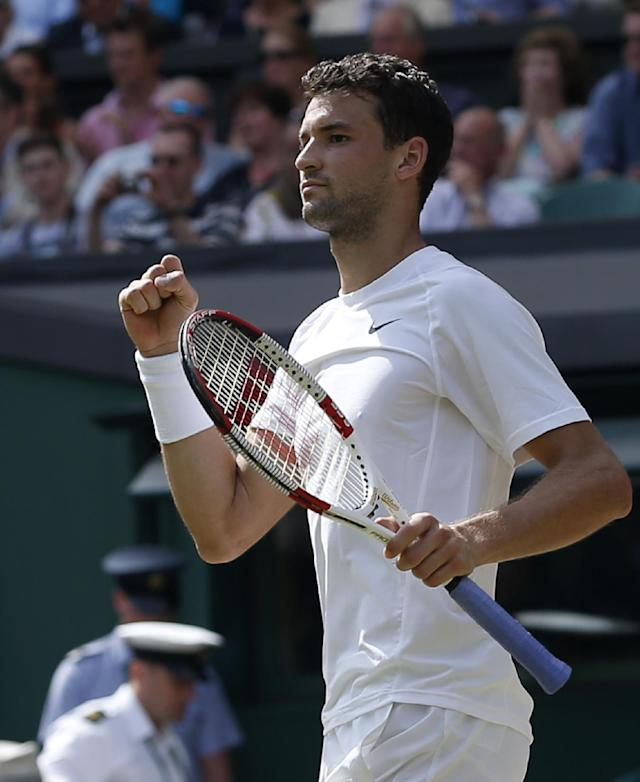 Grigor Dimitrov of Bulgaria celebrates after defeating defending champion Andy Murray of Britain in their men's singles quarterfinal match at the All England Lawn Tennis Championships in Wimbledon, London, Wednesday, July 2, 2014. (AP Photo/Pavel Golovkin)