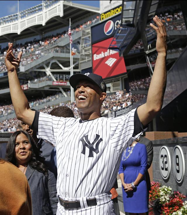 New York Yankees relief pitcher Mariano Rivera acknowledges the crowd from Monument Park during a pregame ceremony at Yankees Stadium before the Yankees baseball game against the San Francisco Giants, Sunday, Sept. 22, 2013, in New York. The 13-time All-Star closer is retiring at the end of this season. (AP Photo/Kathy Willens, Pool)