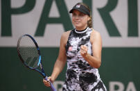 United States's Sofia Kenin celebrates after defeating United States's Hailey Baptiste during their second round match on day 5, of the French Open tennis tournament at Roland Garros in Paris, France, Thursday, June 3, 2021. (AP Photo/Christophe Ena)