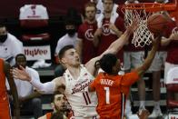 Illinois's Trent Frazier shoots past Wisconsin's Micah Potter during the first half of an NCAA college basketball game Saturday, Feb. 27, 2021, in Madison, Wis. (AP Photo/Morry Gash)