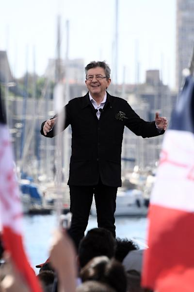 Jean-Luc Melenchon delivers a speech during a public meeting at the Old Port of Marseille, southern France, on April 9, 2017 (AFP Photo/Anne-Christine POUJOULAT            )