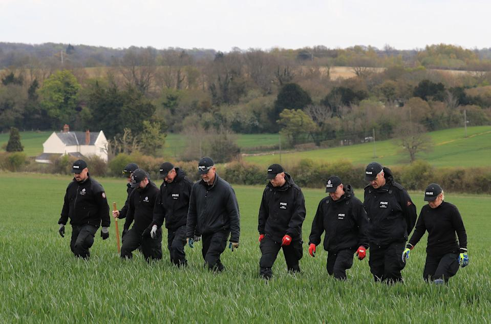 Police officers search fields close to the Kent hamlet of SnowdownPA Wire