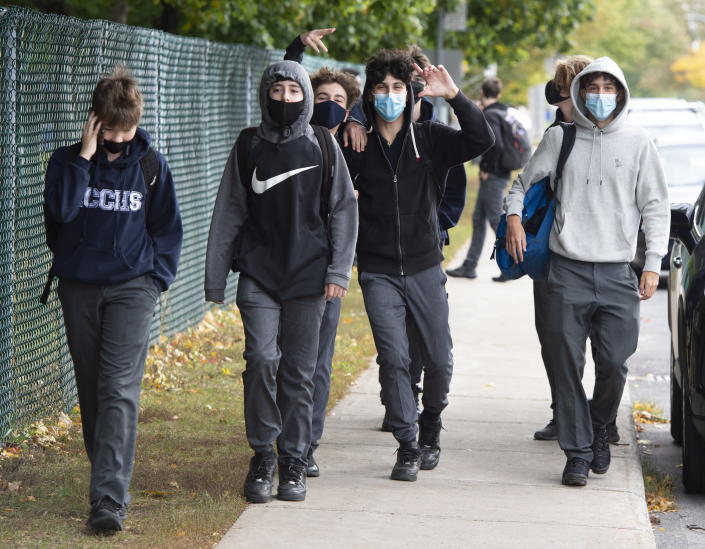 Students from Lasalle Community Comprehensive High School walk out of class to protest COVID-19 safety concerns Thursday, Oct. 1, 2020 in Montreal. (Ryan Remiorz/The Canadian Press via AP)